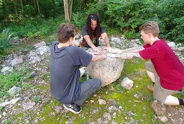 Anyextee leads the intonations with Kaeden & Digby connecting with the ancient sacred stone @ Labna during Adept Expeditions Mysteries of the Maya study trip 2017