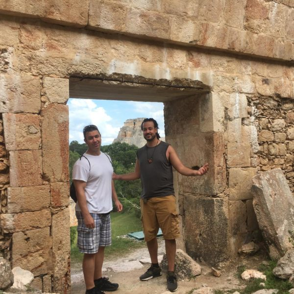 Adept Expeditions: Best selling masonic author & researcher Richard Cassaro & Anyextee at the House of Turtles with the Pyramid of the Magician in the back ground, Uxmal - Mysteries of the Maya study trip - 2017 | Photo by Karina Ceja