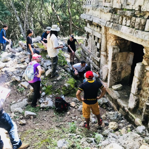 Our expedition team investigates in Xul during Mysteries of the Maya study trip - 2017 | Photo by Carl Webley